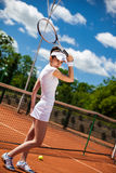 Female playing tennis Stock Photos