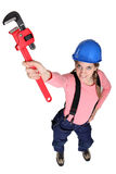 Female plulmber holding wrench Royalty Free Stock Photos