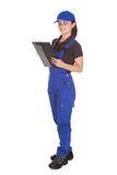 Female plumber holding clipboard Stock Photos