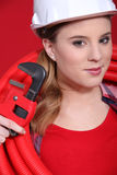 Female plumber in red Royalty Free Stock Photo