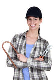 Female plumber with tools Stock Image