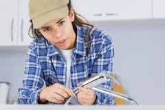 Female plumber working on sink royalty free stock photos