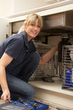 Female Plumber Working On Sink Stock Photography