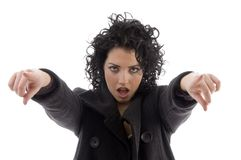 Female pointing with both hands Royalty Free Stock Images