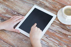 Female pointing finger to tablet pc screen Stock Photos