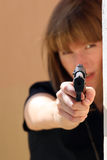 Female pointing gun Stock Images