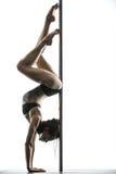 Female pole dancer posing in studio Royalty Free Stock Photos