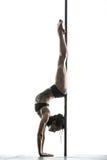 Female pole dancer posing in studio Stock Image