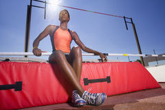 Female pole vault athlete, low angle view (lens flare) Royalty Free Stock Photography