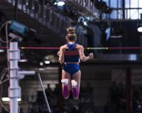 Female pole vaulter clearing the bar stock image