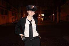 Female police officer. At night Royalty Free Stock Photos