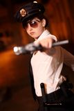 Female police officer. With gun at night Stock Image