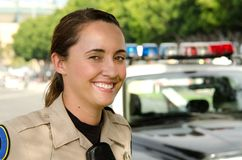 Female police officer. A female police officer smiles during her shift Royalty Free Stock Photo