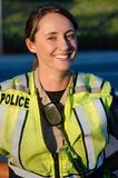 Female police officer. A female police officer smiles during her shift Stock Photo