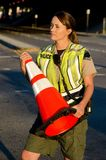 Female police officer. A female police officer holding a traffic cone during a traffic control shift Royalty Free Stock Photography