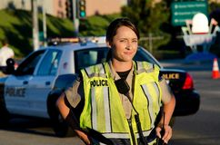 Female police officer. A female police officer staring and looking serious during a traffic control shift Royalty Free Stock Image