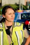 Female police officer. A female police officer staring and looking serious during a traffic control shift Stock Images