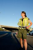 Female police officer. A female police officer staring and looking serious during a traffic control shift Stock Image