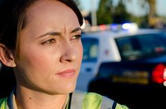 Female police officer. A female police officer staring and looking serious during a traffic control shift Royalty Free Stock Images