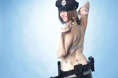 Female police officer with cuffs. Sexy female police officer playing with handcuffs Stock Image