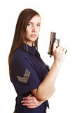 Female police officer with gun. Young female police officer with a pistol in her hand Royalty Free Stock Images