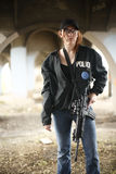 Female Police Officer with rifle. A female police officer holding an assault rifle Royalty Free Stock Photo