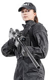 Female police officer. SWAT in black uniform with sniper rifle studio shot Stock Images