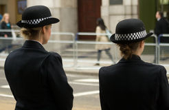 Female Police Officers line funeral route Stock Photos