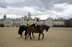 Female police riding horse in London England Royalty Free Stock Photography