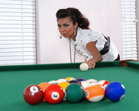 Female pool player. Getting ready to break with her first shot stock photography