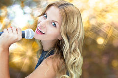 Female Pop Star with gold light Royalty Free Stock Photography