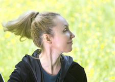 Female portrait against a meadow Stock Photo