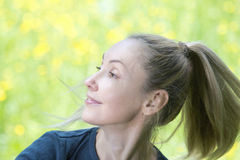 Female portrait against a meadow Royalty Free Stock Photo