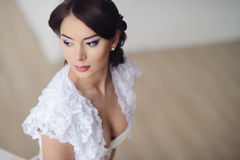 Female portrait of cute lady in white bra indoors Stock Photography