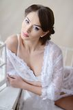 Female portrait of cute lady in white bra indoors Royalty Free Stock Photography