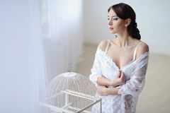 Female portrait of cute lady in white bra indoors Stock Image