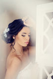 Female portrait of cute lady in white bra indoors Royalty Free Stock Photo