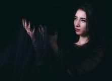 Female portrait on dark background Royalty Free Stock Photo