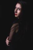 Female portrait on dark background Stock Images