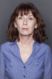 Female portrait of fragile 50s woman Stock Photo