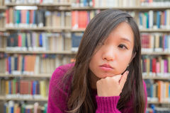 Female Portrait in Library. Close portrait of young woman in library Royalty Free Stock Image
