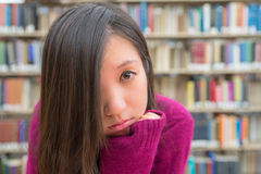 Female Portrait in Library. Close portrait of young woman in library Royalty Free Stock Images