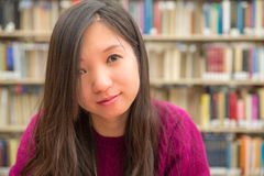Female Portrait in Library. Close portrait of young woman in library Stock Photography