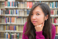 Female Portrait in Library. Close portrait of young woman in library Stock Image