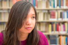 Female Portrait in Library. Close portrait of young woman in library Royalty Free Stock Photo
