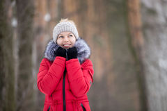 Female portrait outdoors in red winter jacket Stock Images