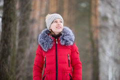 Female portrait outdoors in winter bright red jacket Royalty Free Stock Photography
