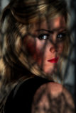 Female portrait in shadows. Portrait of a beautiful woman / model Stock Photography
