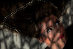 Female portrait in shadows Royalty Free Stock Photos