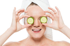 Female portrait with slices of fresh cucumber near eyes close-up Stock Image